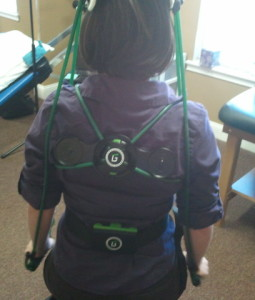 girl wearing gravity fitness exercise equipment at Australian Physiotherapy Specialists